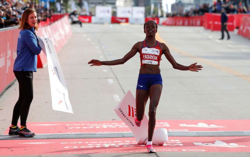a group of people walking on the court: Chicago Marathon - Kenya's Brigid Kosgei wins the women's marathon setting a new world record