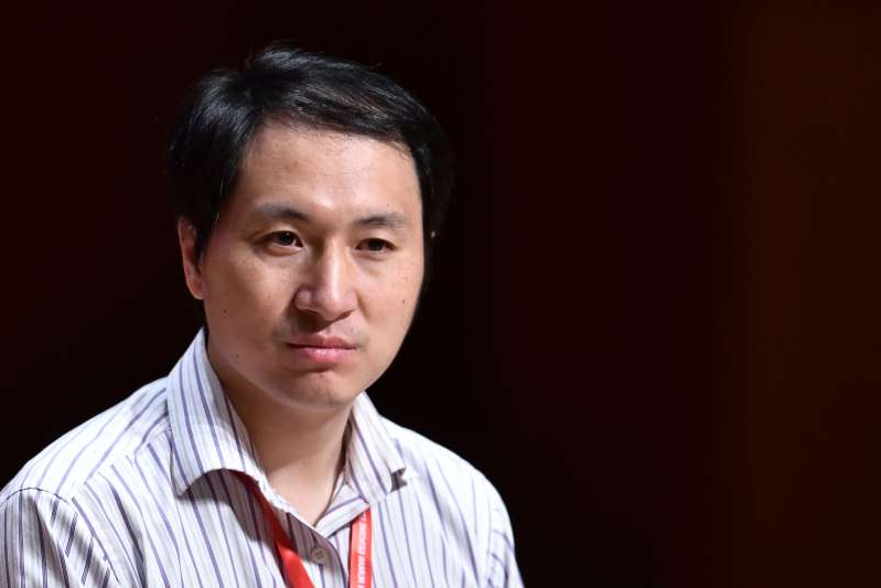 a man wearing a striped shirt: He Jiankui announced the world's first gene edited babies had been born in 2018. Research published in June suggested people with a mutation to the CCR5 gene may face a lower life expectancy.