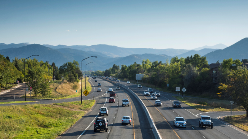 a view of a car going down the highway: cars driving on highway in boulder, colorado