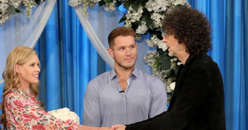 Colton Underwood, Beth Stern standing in front of a window: Howard Stern and Wife Beth Remarry After 11 Years in Surprise Wedding — Led by Colton Underwood!