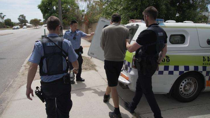 a group of people standing in a parking lot: Police arrested and charged five people over the series of thefts across Perth.