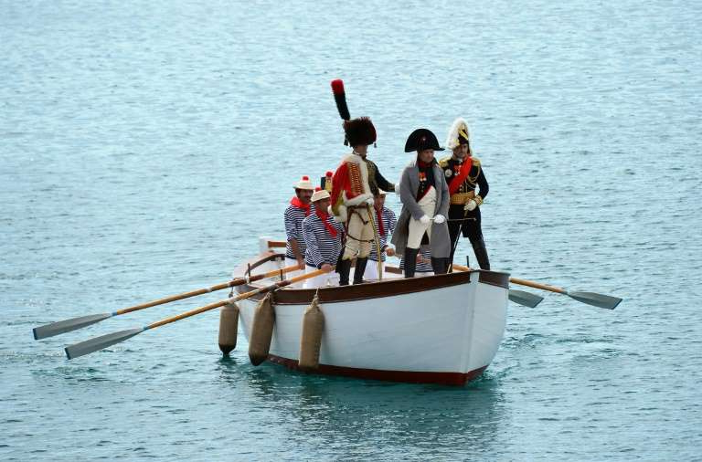 a man riding on the back of a boat in a body of water: A 2014 reenactment of the arrival at the Italian island of Elba of French emperor Napoleon Bonaparte, whom US President Donald Trump suggested, tongue-in-cheek, could help Syria protect the Kurds