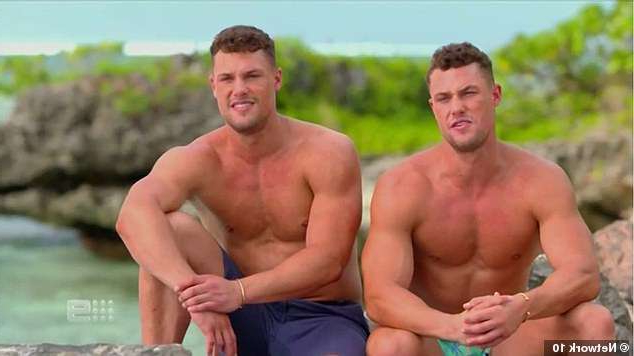 a man sitting at a beach: Double trouble! 25-year-old twin intruders Josh and Luke Packham are about to make their move on Londoner Cassie Landsell, 26
