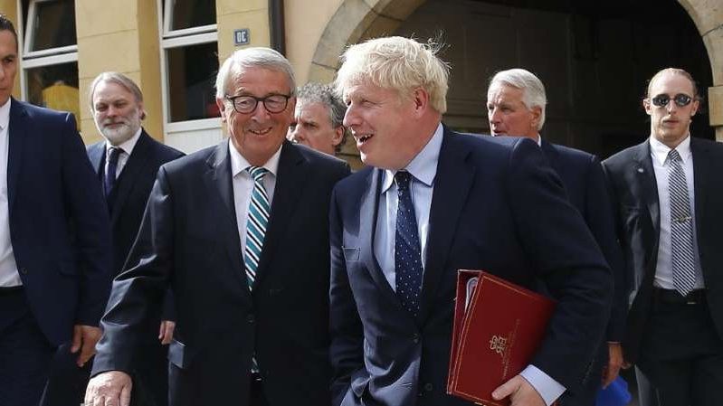 Boris Johnson, Tim Barrow standing next to a man in a suit and tie: According to the BBC, the emergency Brexit summit among EU leaders may be held towards the end of the month [Julien Warnand/EPA]