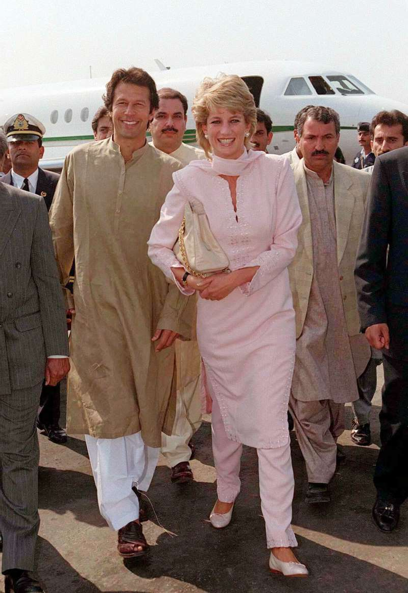 Diana, Princess of Wales, Imran Khan posing for the camera: Diana, The Princess of Wales, wore a tradional shalwar kameez when she arrived in Lahore, Pakistan in April 1996. [Photo: Getty]