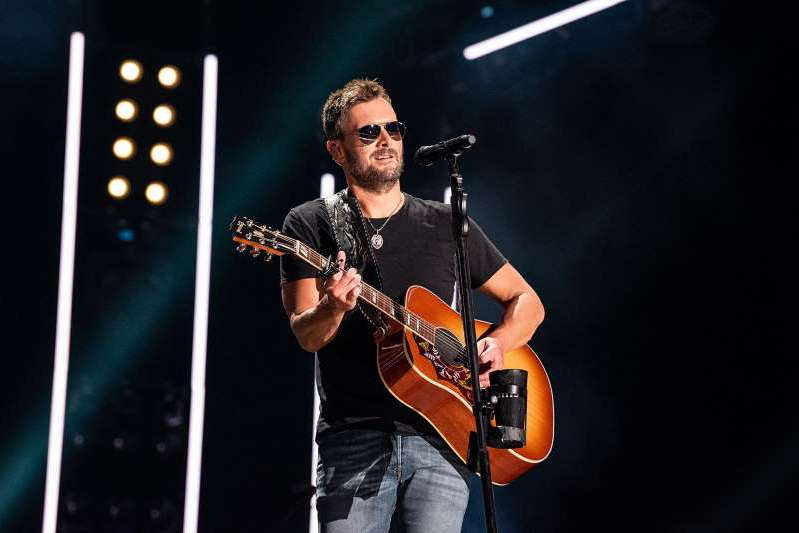 Eric Church standing on a stage