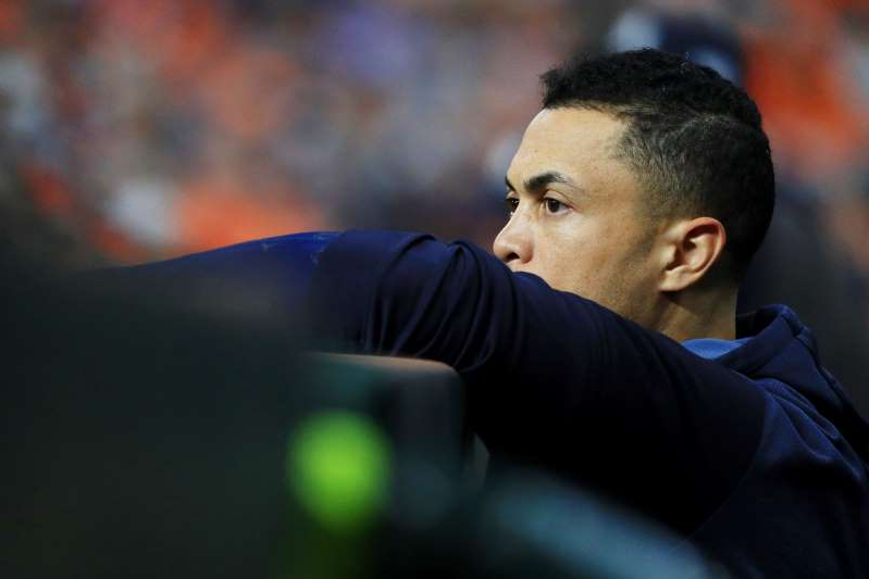 HOUSTON, TEXAS - OCTOBER 13: Giancarlo Stanton #27 of the New York Yankees looks on in game two of the American League Championship Series against the Houston Astros at Minute Maid Park on October 13, 2019 in Houston, Texas. (Photo by Mike Ehrmann/Getty Images)