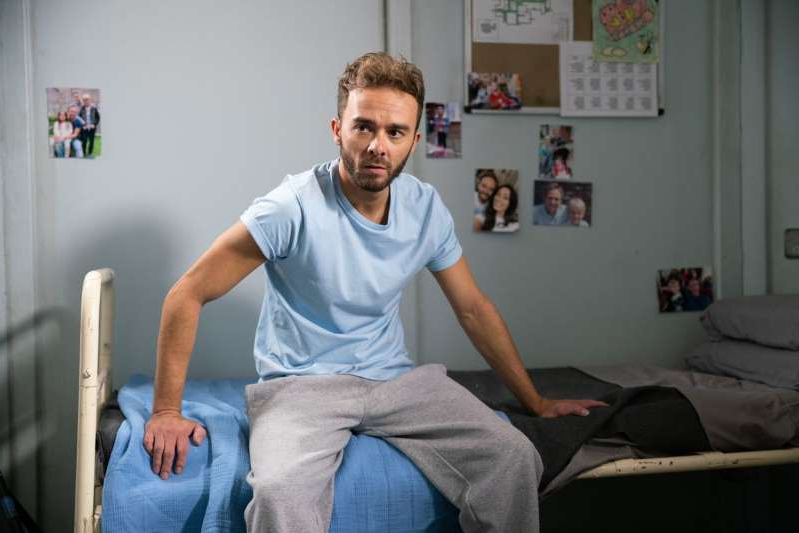 Jack P. Shepherd sitting in a room: A riot has broken out at the prison.
