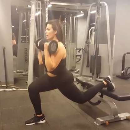 Slide 3 of 11: Ashley Graham takes this rear-foot elevated split squat (AKA a Bulgarian split squat) up a notch with weights for some serious butt and leg sculpting. (There's more where that came from: See 12 Times Ashley Graham Showed Us What Fitspo Was Really About.)