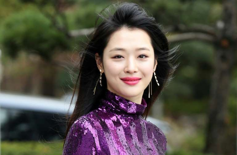 Sulli wearing a purple dress: Sulli was a product of South Korea's fiercely competitive show business industry