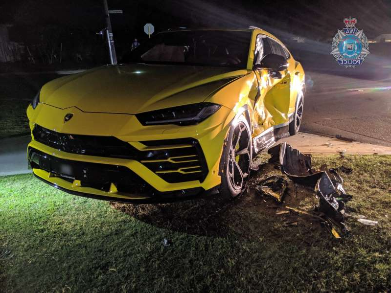 a black and yellow car in a parking lot: The 14-year-old crashed a stolen vehicle into a yellow Lamborghini.