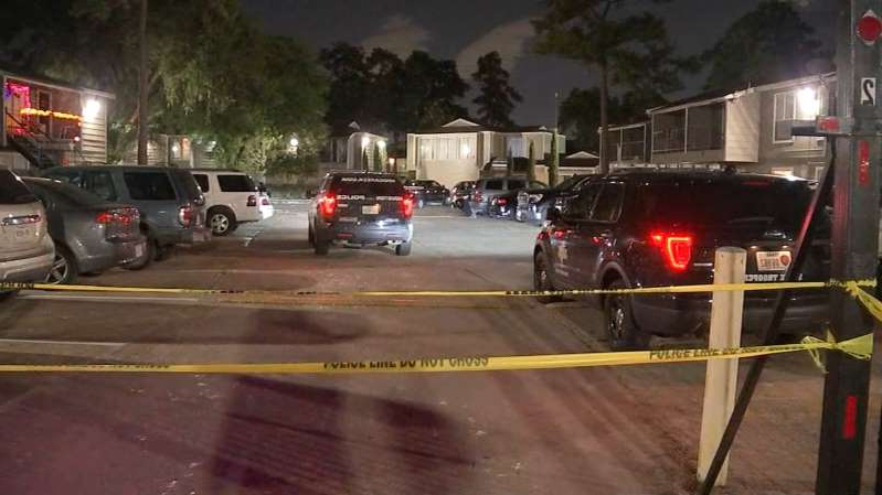 a car parked on the side of a road: 4 Houston teens shot in 6 days span
