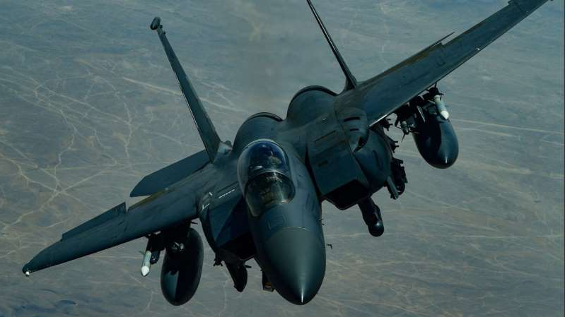 a propeller plane that is flying in the air: A U.S. Air Force F-15E Strike Eagle descends after receiving fuel from a KC-10 Extender, assigned to the 908th Expeditionary Air Refueling Squadron, out of Al Dhafra Air Base, United Arab Emirates, above an undisclosed location, Sept. 1, 2019.