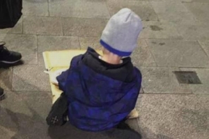 Outrage as homeless boy 'Sam', 5, pictured eating dinner off cardboard on Dublin street