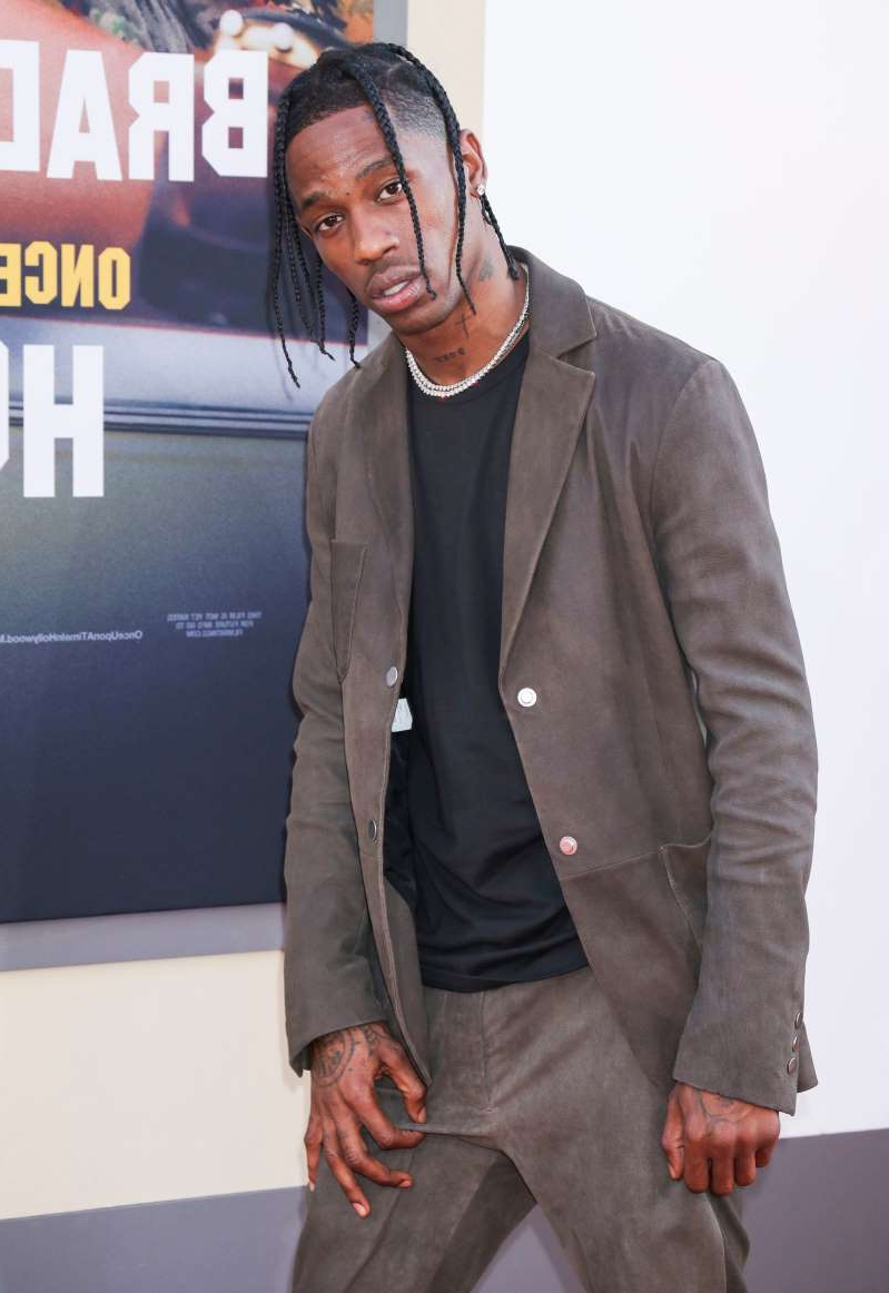Travis Scott wearing a suit and tie: Travis Scott arrives at the premiere of