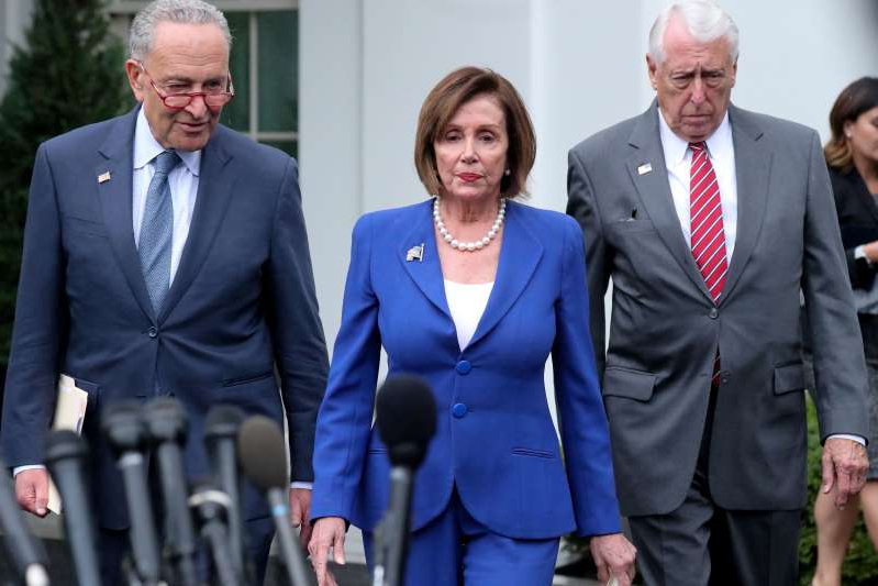 U.S. House Speaker Nancy Pelosi (D-CA) walks out with Senate Minority Leader Chuck Schumer (D-NY) and House Majority Leader Steny Hoyer (D-MD) to speak with reporters after meeting with President Donald Trump at the White House in Washington, U.S., October 16, 2019.  REUTERS/Jonathan Ernst