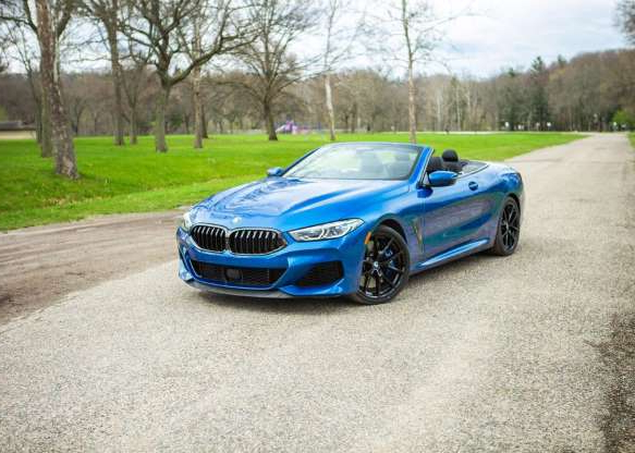 a car parked on the side of a road: The 2019 BMW M850i Convertible exemplifies the style, comfort and performance we expect from a grand touring car.