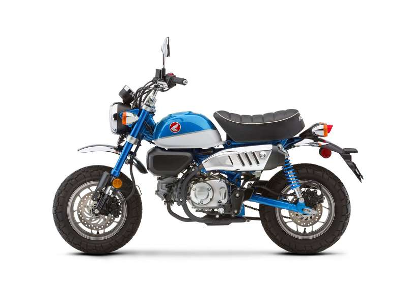 a motorcycle parked on the side of the road: The Monkey loses one color and gains another (this Pearl Glittering Blue) for 2020, but returns otherwise untouched. An ABS option is available for $200 more.