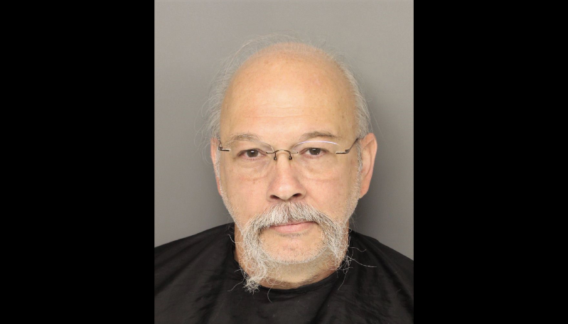 a person posing for the camera: Norman Earl Gardner, Jr., 56, is charged with reckless driving in a road rage incident that ended in a crash that critically injured a 13-year old boy.