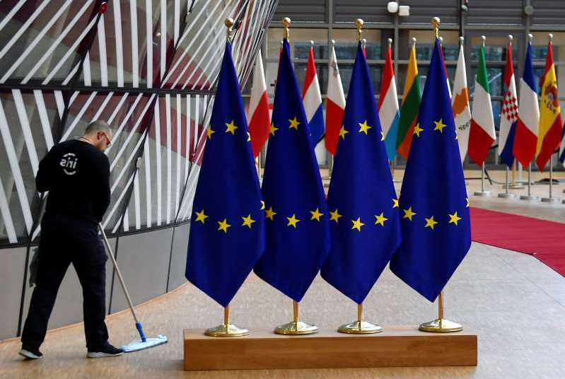 a person wearing a suit and tie: European Union leaders summit in Brussels