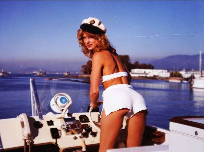 Dorothy Stratten in a white boat sitting next to a body of water: Vancouvers Dorothy Stratten, who moved to Hollywood and became Playmate of the Year in 1980 before being murdered by her estranged husband and manager, is the subject of a new 20/20 documentary airing on ABC this Friday.