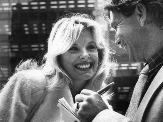 Dorothy Stratten talking on a cell phone:  Playboy Playmate Dorothy Stratten is pictured with Vancouver Sun writer Lloyd Dykk in this archival photo.