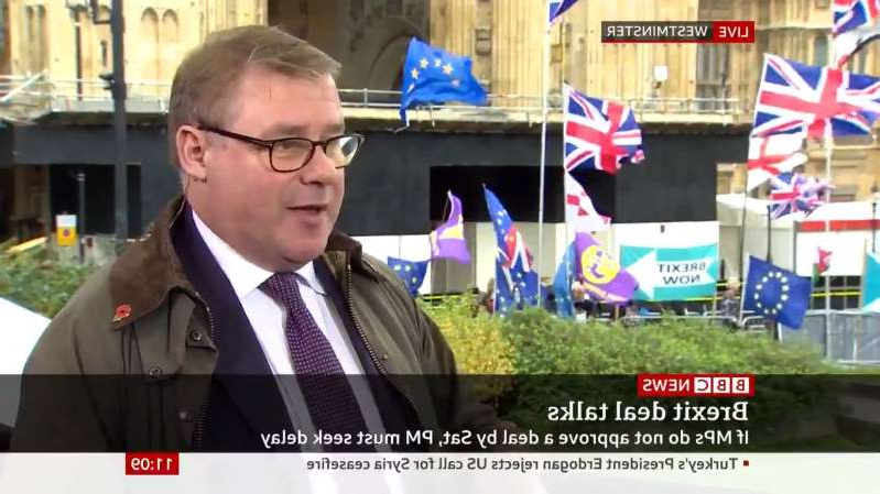 Mark Francois wearing a suit and tie
