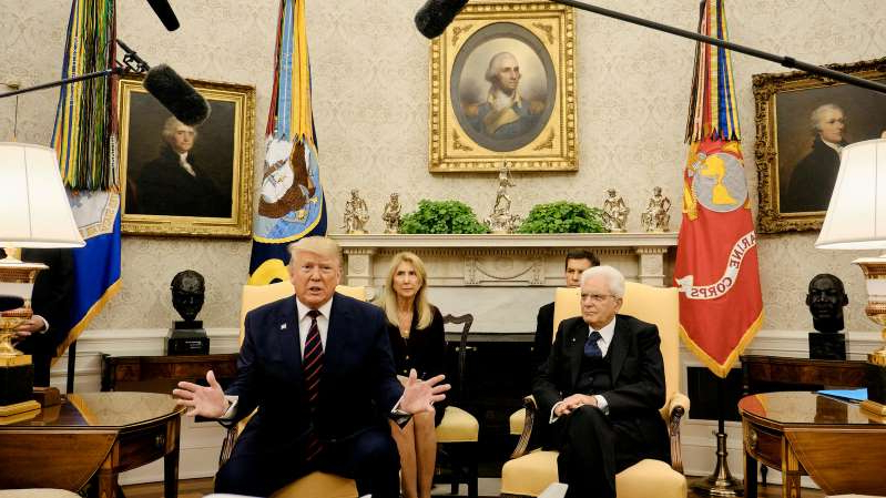 Sergio Mattarella, Donald Trump sitting at a desk: President Trump, with President Sergio Mattarella of Italy, speaking to reporters on Wednesday in the Oval Office.
