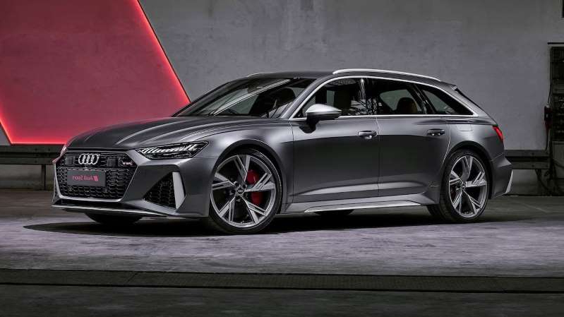 a car parked on the side of a road: 2020 Audi RS 6 Avant front three quarter