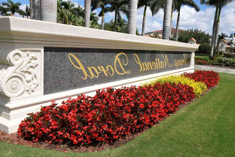 a close up of a flower garden in front of a building: Trump National Doral golf resort in Miami