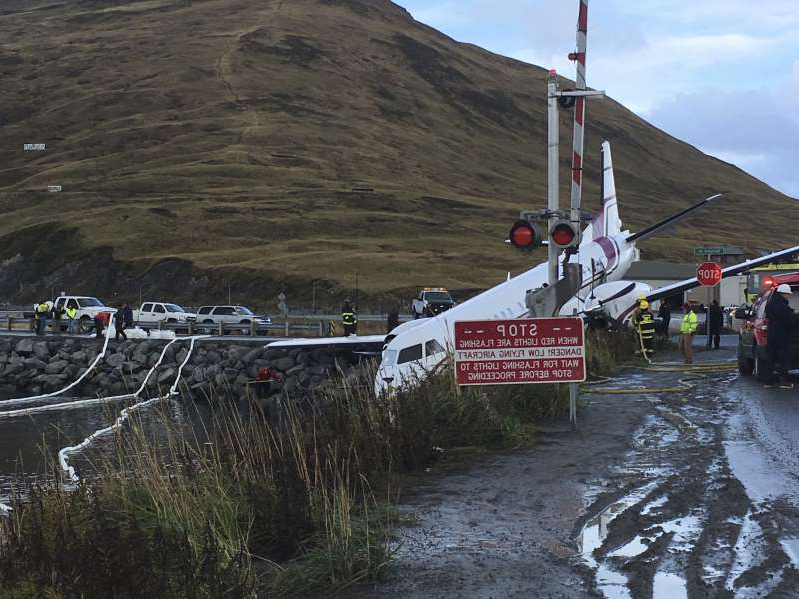 A commuter airplane has crashed near the airport in a small Alaska community on the Bering Sea, Thursday, Oct. 17, 2019, in Unalaska, Alaska. Freelance photographer Jim Paulin says the crash at the Unalaska airport occurred Thursday after 5 p.m. Paulin says the Peninsula Airways flight from Anchorage to Dutch Harbor landed about 500 feet (152 meters) beyond the airport near the water. (Jim Paulin via AP)