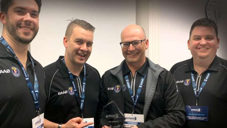 a group of people posing for the camera: Andrew Bailey, Ben Cornish, Adam McHugh and Luke Smith from Saab Australia placed first in the National Missing Persons Hackathon. (Supplied: Saab Australia)