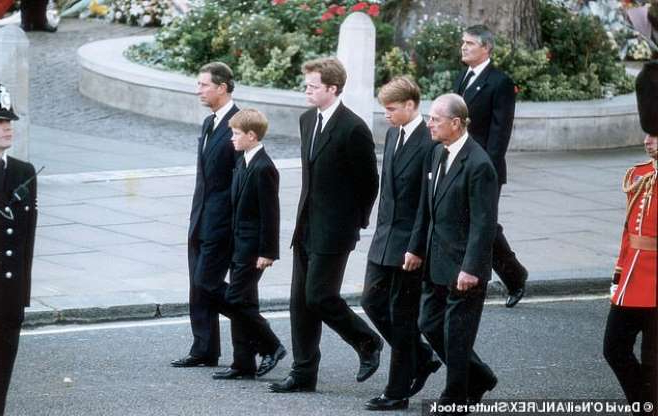 a group of people walking down the street: Prince Harry (second from right) walks behind his mother Diana's coffin alongside Prince Philip, Prince William, Earl Spencer and Prince Charles