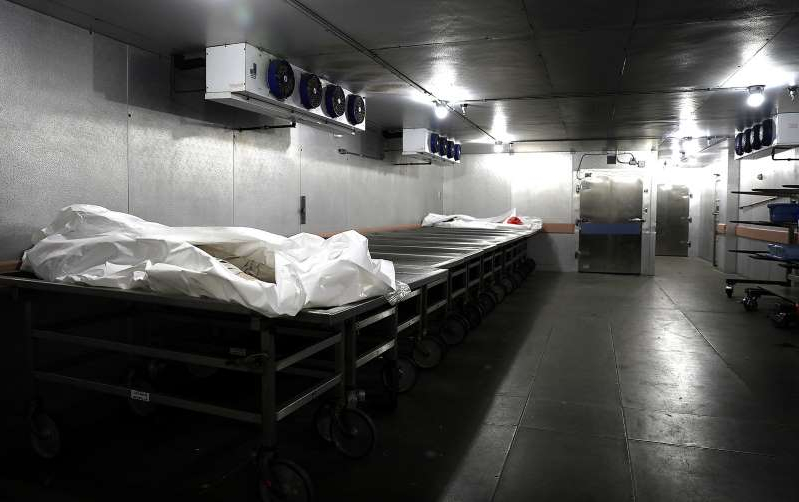 a large room: Two bodies lay inside the cooler at the Pierce County Medical Examiner's office in Tacoma, Washington.