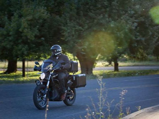 a man riding a motorcycle down a dirt road: The Zero DSR Black Forest will most likely spend most of its time on the streets, and that's perfectly fine. The bike should be comfortable over the long haul and most real adventure rides require you to log some serious highway miles.