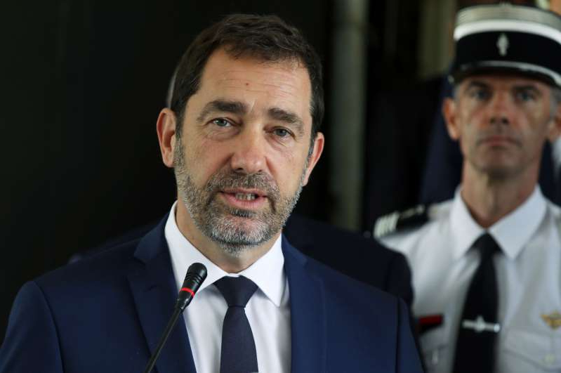 a man wearing a suit and tie: French Interior Minister Christophe Castaner speaks during a joint news conference with Ivory Coast security minister Sidiki Diakite in Abidjan