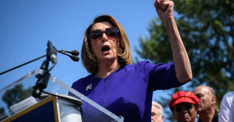 a man wearing sunglasses: House Speaker Nancy Pelosi speaks at a Fed Up? Rise Up! rally outside the US Capitol in Washington, DC September 24, 2019.