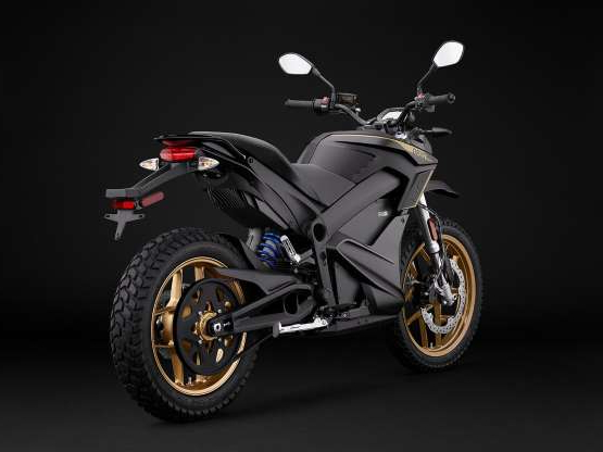 a motorcycle parked on the side of a road: The 2020 Zero DSR ($15,495, $18,390 with Power Tank) is the middle-of-the-road offering in the dual sport lineup. The DSR has a range of 160 miles or 200 miles with the Power Tank.