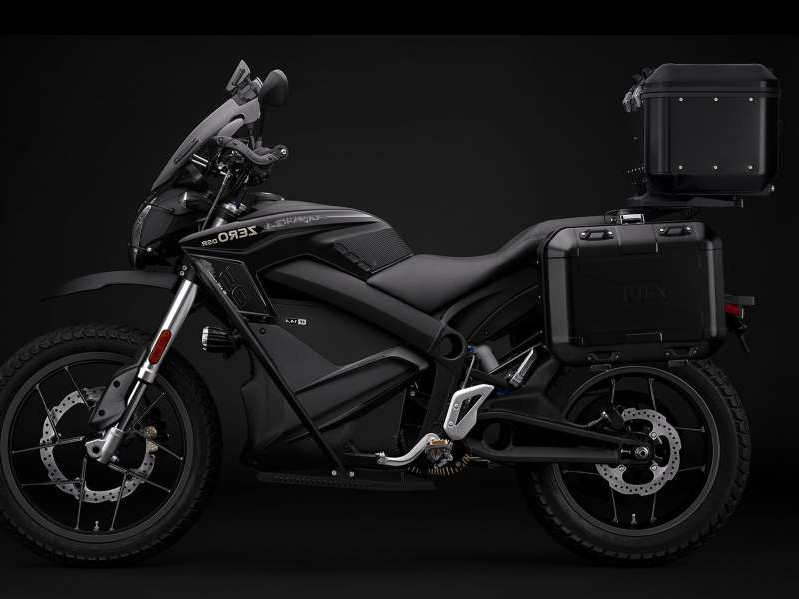 a person riding on the back of a motorcycle: What separates the 2020 Zero DSR Black Forest from the DSR is the adventure-touring equipment that includes the premium hard luggage, crashbars, and touring windshield to name a few. It's basically the eADV bike you never knew you wanted.
