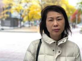 a woman looking at the camera: Jenny Wu stands outside the Ottawa Courthouse on Oct. 18, 2019. Wu said she and her daughters still mourn the loss of husband and father Giai Ly, killed when a speeding tow truck ran a red light and slammed into his car in November 2015.
