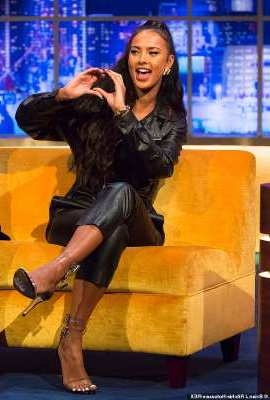 a woman sitting on a bench talking on a cell phone: Single: Maya Jama, 25, revealed she isn't 'on the hunt' for a new beau and is happy being single while appearing on The Jonathan Ross show - two months after splitting from Stormzy