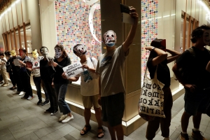 Hong Kong protesters don cartoon masks to defy face mask ban