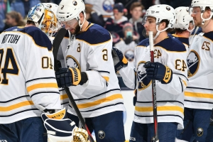Hutton sets Sabres record with 47-save shutout in win over Kings