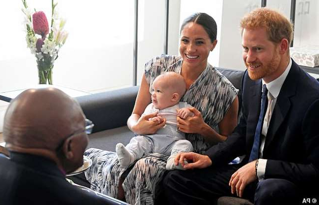 Prince Harry, Meghan Markle sitting on a couch: The Duke and Duchess of Sussex and their son Archie meet with Archbishop Desmond Tutu and Mrs Tutu at their legacy foundation in Cape Town, on day three of their tour of Africa last month