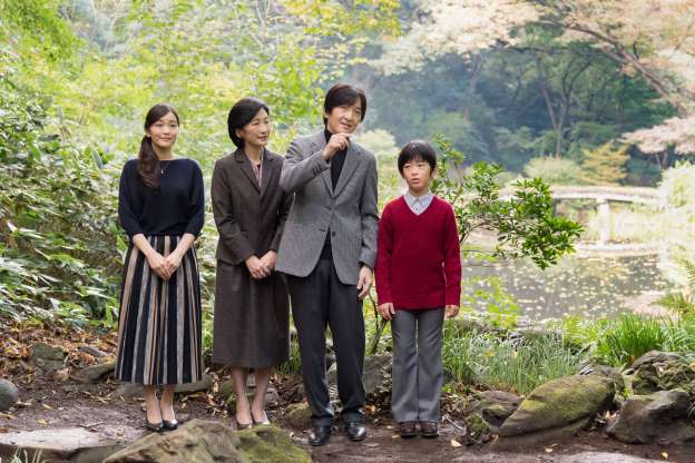 Prince Hisahito of Akishino, Prince Akishino, Princess Akishino, Princess Mako of Akishino standing next to a tree: FILE PHOTO: Japan's Prince Akishino and his wife Princess Kiko stroll in the garden for a family photo with their children Prince Hisahito and Princess Mako, at their residence in Tokyo