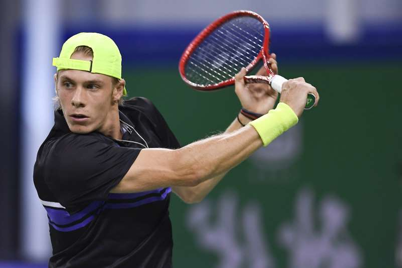 SHANGHAI, CHINA - OCTOBER 09: Dennis Shapovalov of Canada in action against Novak Djokovic of Serbia on day five of 2019 Rolex Shanghai Masters at Qi Zhong Tennis Centre on October 8, 2019 in Shanghai, China. (Photo by Fred Lee/Getty Images)