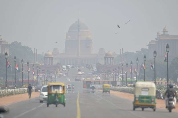 Slide 11 of 30: Heavy air pollution is pictured around Rashtrapati Bhavan and government buildings in New Delhi on October 15, 2019. - New Delhi banned the use of diesel generators on October 15 as pollution levels in the Indian capital exceeded safe limits by more than four times. (Photo by Sajjad HUSSAIN / AFP) (Photo by SAJJAD HUSSAIN/AFP via Getty Images)