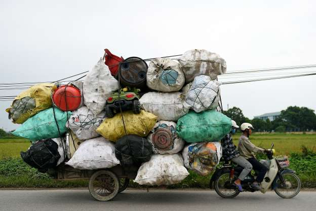 Slide 15 of 30: Waste collectors transport plastic scrap for recycling in the suburbs of Hanoi on October 15, 2019. (Photo by Nhac NGUYEN / AFP) (Photo by NHAC NGUYEN/AFP via Getty Images)