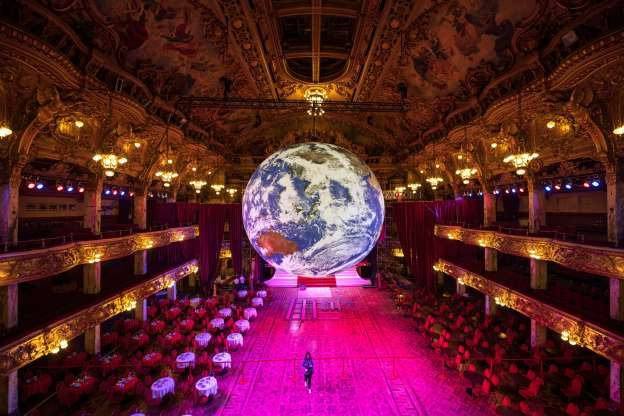 Slide 16 of 30: Members of the public admire an illuminated art installation entitled 'Gaia' by artist Luke Jerram in the Blackpool Tower Ballroom, as part of the Lightpool Festival of visual arts in the centre of Blackpool, northern England on October 14, 2019. - The annual festival, which runs until October 26, 21019, features a mix of live performance and light-based art installations at various locations throughout the town. (Photo by OLI SCARFF / AFP) / RESTRICTED TO EDITORIAL USE - MANDATORY MENTION OF THE ARTIST UPON PUBLICATION - TO ILLUSTRATE THE EVENT AS SPECIFIED IN THE CAPTION (Photo by OLI SCARFF/AFP via Getty Images)