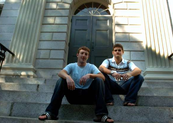 Slide 2 of 28: CAMBRIDGE - NOVEMBER 12: Founder of Facebook.com Mark Zuckerberg, right, and Dustin Moscovitz, co-founder, left; have their photo taken at Harvard Yard. The two are students at Harvard University who are taking the semester off. (Photo by Justine Hunt/The Boston Globe via Getty Images)